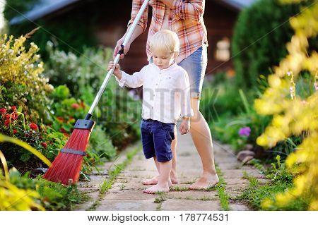 Toddler Boy Helping Clean Footpath