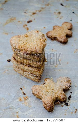 A stack of cookies on baking paper. Selective focus