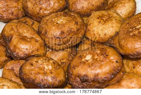 Donuts frying in deep fat. Preparation of traditional donuts Homemade fried donuts
