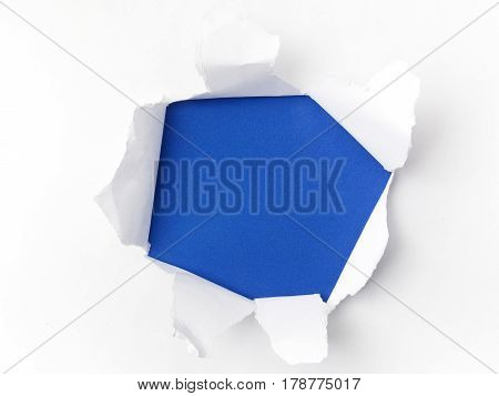 torn white paper on blue background. Concept for autism awareness day.