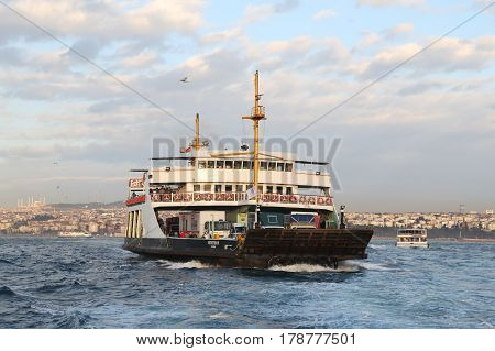ISTANBUL TURKEY - MARCH 20 2017: Istanbul Deniz Otobusleri ferry passing from Asian to European side of Istanbul. 18 ferries in 3 different types carry passengers and vehicles between Sirkeci and Harem.