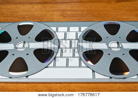 Two compact discs in the form of a retro reel lie on the keyboard