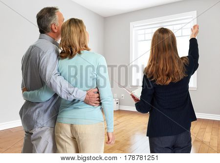 Senior couple with realtor