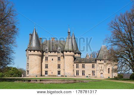 Chateau de Grenerie in French village Salon-la-Tour in Limousin