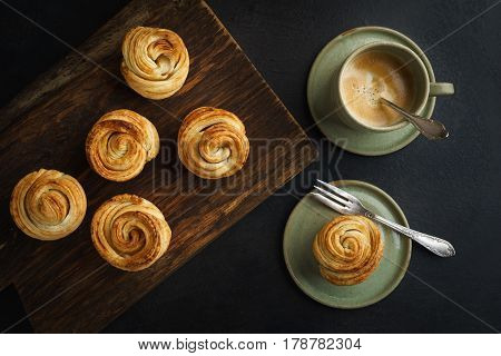 Fresh baked cruffins trend pastry in baking tin from above