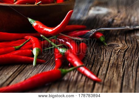 Red Hot Chili Pepper On Vintage Silver Fork Over Wooden Background