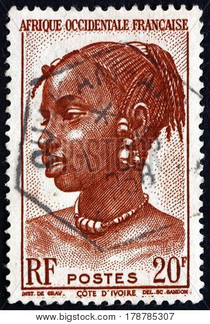 FRENCH WEST AFRICA - CIRCA 1947: a stamp printed in the France shows Agni Woman Ivory Coast circa 1947