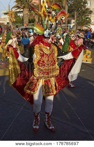 ARICA, CHILE - FEBRUARY 10, 2017:Masked Diablada dancer in ornate costume performing at the annual Carnaval Andino con la Fuerza del Sol in Arica, Chile
