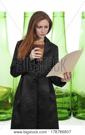 Beautiful young woman lawyer or business woman holding a manila file folder