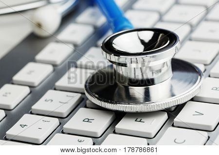 closeup on a medical stethoscope on keyboard