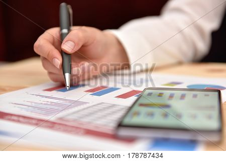 Businesswoman Analyzing Report