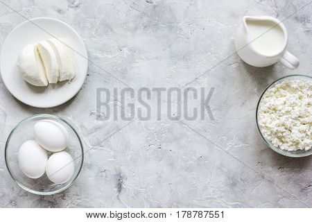 Fresh dairy products for healthy breakfast on stone table background top view mock up