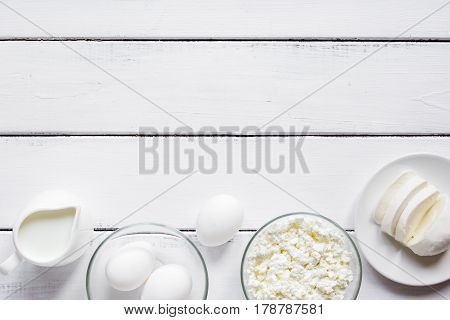 fresh dairy products for proteic meal on white wooden table background top view mock-up