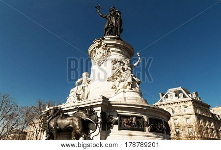 The Marianne statue on the Republic square in Paris France.