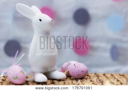 Funny Easter rabbit, colored eggs and flowers. Horizontal shot. Happy Easter