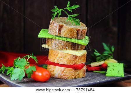 sandwich with three cheeses ,parsley and fresh tomatoes