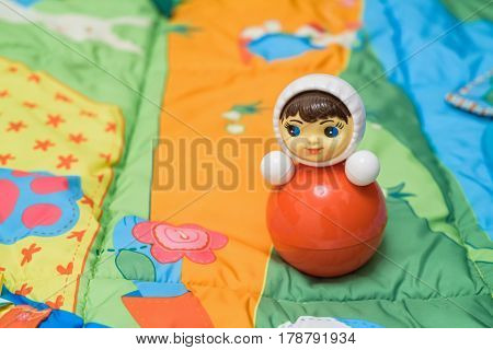 Close up of plastic tubler toy on colorful mat