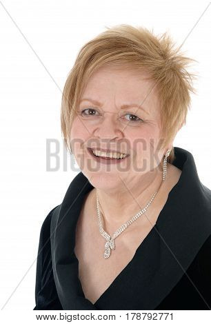 A closeup portrait of a happy smiling senior citizen woman wearing a necklace isolated for white background.
