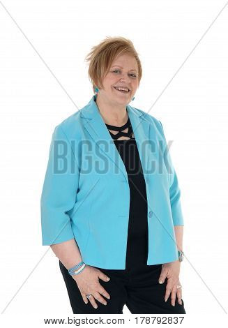 A senior citizen woman with blond hair wearing a blue jacket standing smiling isolated for white background.