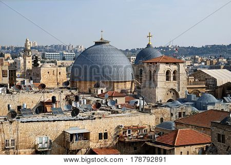 JERUSALEM, ISRAEL - MARCH 25, 2017: Top view of two Gray domes of the Holy Sepulcher Church in old city of Jerusalem