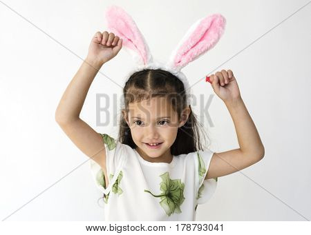 Little cute and adorable girl smiling with bunny headband studio portrait