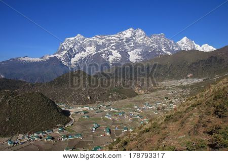 Sherpa village Khumjung and high mountains. Spring scene in the Everest National Park Nepal.