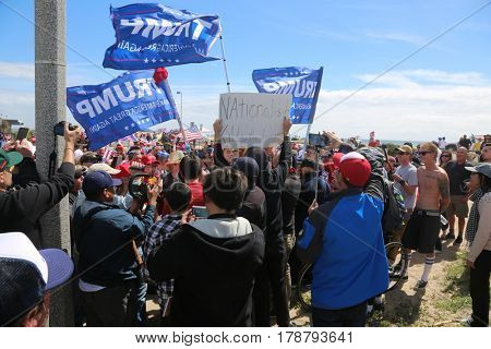 Huntington Beach, CA - March 25 2017: Make America Great Again March. Supporters and protesters of republican president Donald Trump, cheer and jeer at a MAGA March in Huntington Beach.