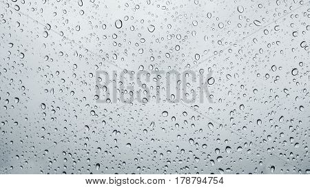 water drops on window glass texture background