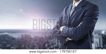Businessman in front of a bright city