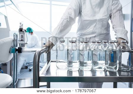Flasks with liquids in a lab - Pharmaceutical industry factory and production laboratory (color toned image; shallow DOF)