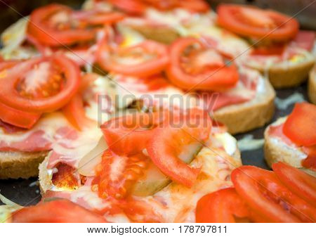 Colorful sandwich with margarine, pickles, cheese and fresh tomato