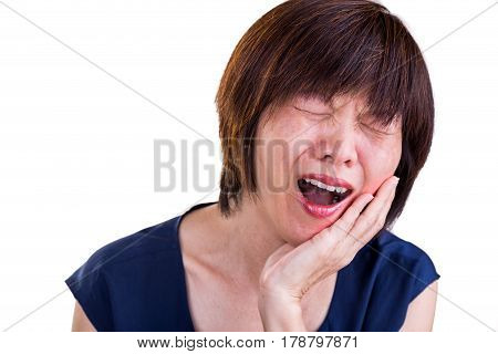 Asian Woman Suffering Intense Toothache Pain With Hands Over Face