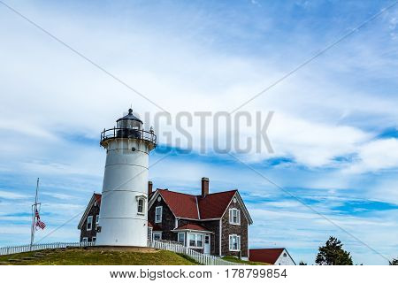 Nobska Light or Nobsque Light also known as Nobska Point Light is a lighthouse located at the division between Buzzards Bay and Vineyard Sound in Woods Hole Massachusetts on the southwestern tip of Cape Cod Massachusetts.