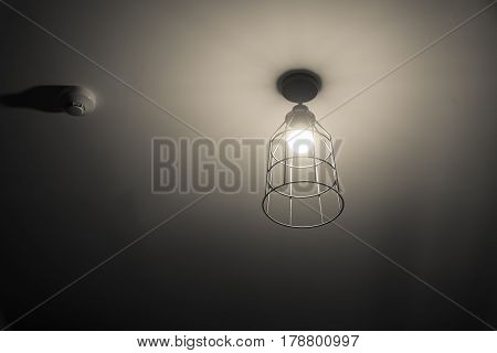 Open bright light steel gray lamp on the wall