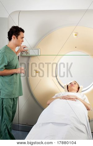 A patient and CT Scan Technician preparing for an x-ray