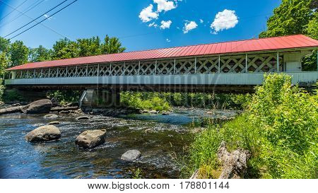The Ashuelot Covered Bridge is a historic wooden covered bridge over the Ashuelot River on Bolton Road just south of its intersection with NH 119 in Ashuelot New Hampshire.