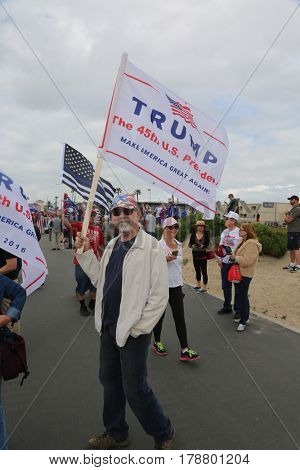 Huntington Beach, CA - March 25 2017: Make America Great Again March. Thousands of Supporters of republican president Donald Trump wave signs cheer and march at a MAGA Parade in Huntington Beach CA.