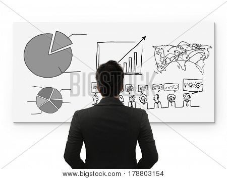 Business person standing near a White Board
