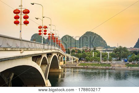Guilin, China - September 22, 2016: Bridge Over Li River In The City Central Area Decorated With Chi