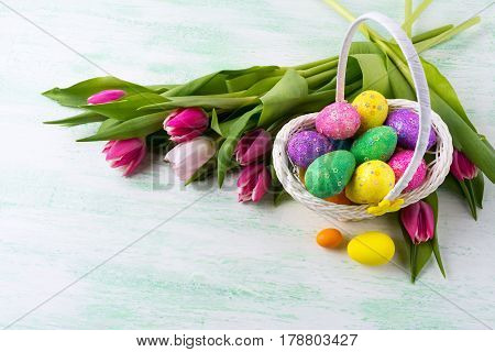 Easter Star Decorated Glitter Eggs In Yellow Wicker Basket Background.