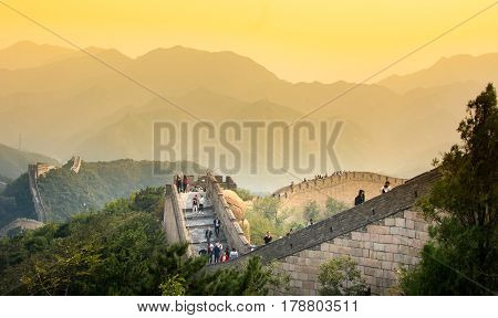 Beijing, China - September 29, 2016: Tourists Walking On The Great Wall Of China At Sunset Time