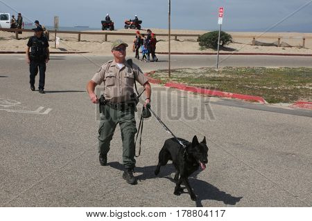 Huntington Beach, CA - March 25 2017: Make America Great Again March. Supporters of republican president Donald Trump, along with police bring their dogs and horses to  a MAGA March.