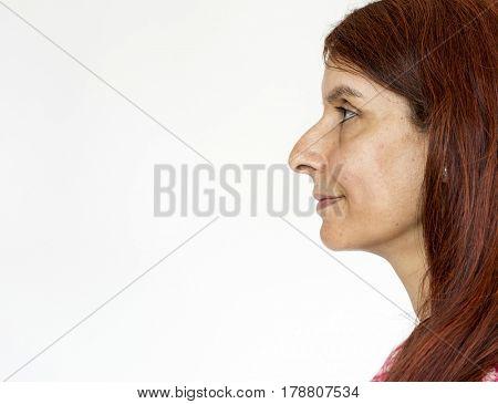 Mature woman smiling casual studio portrait