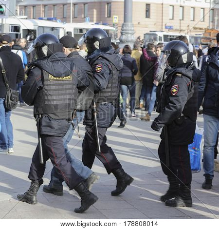 Moscow, Russia - March, 26, 2017: Policemen arest a demonstrant on a protest demonstration in Moscow, Russia