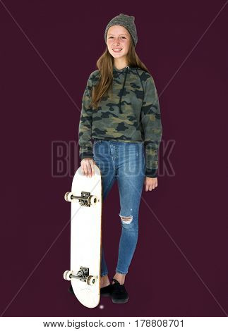 Young student girl standing with skateboard