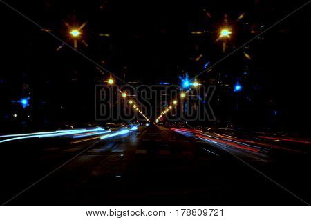 light trails in motion at night on street