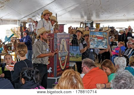 GAP PENNSYLVANIA - MARCH 25 2017: Amish volunteers sell art and craft items under a tent at the annual