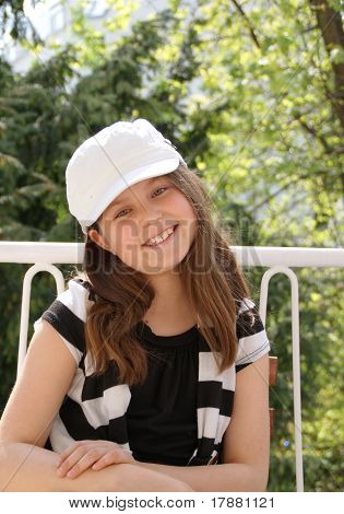 girl with cap smiling
