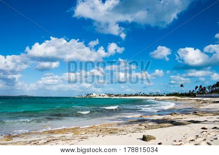 A beautiful view of the beach with green tropical vegetation and sunlight. New Providence, Nassau, Bahamas.