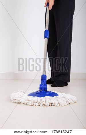 Woman Legs With Mop Cleaning Floor